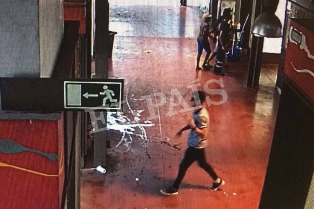 In this watermarked frame grab from CCTV released by the Spanish newspaper El Pais on Monday Aug. 21, 2017, a suspect believed to be Younes Abouyaaqoub is is captured by a security camera walking  ...