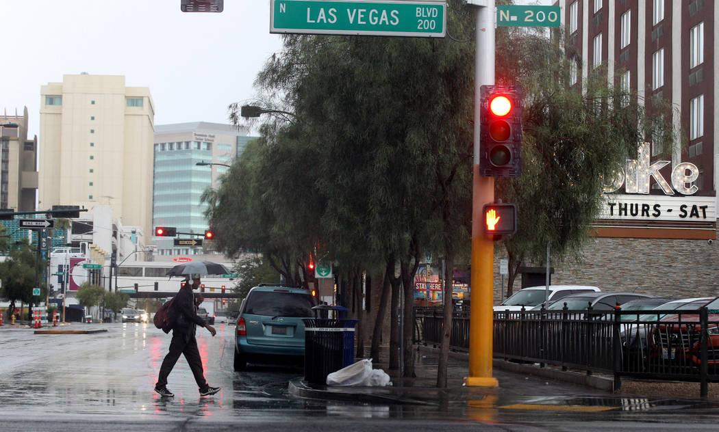 Light rain falls at Las Vegas Boulevard North at East Ogden Avenue in downtown Las Vegas on Monday, Aug. 21, 2017. (K.M. Cannon/Las Vegas Review-Journal) @KMCannonPhoto
