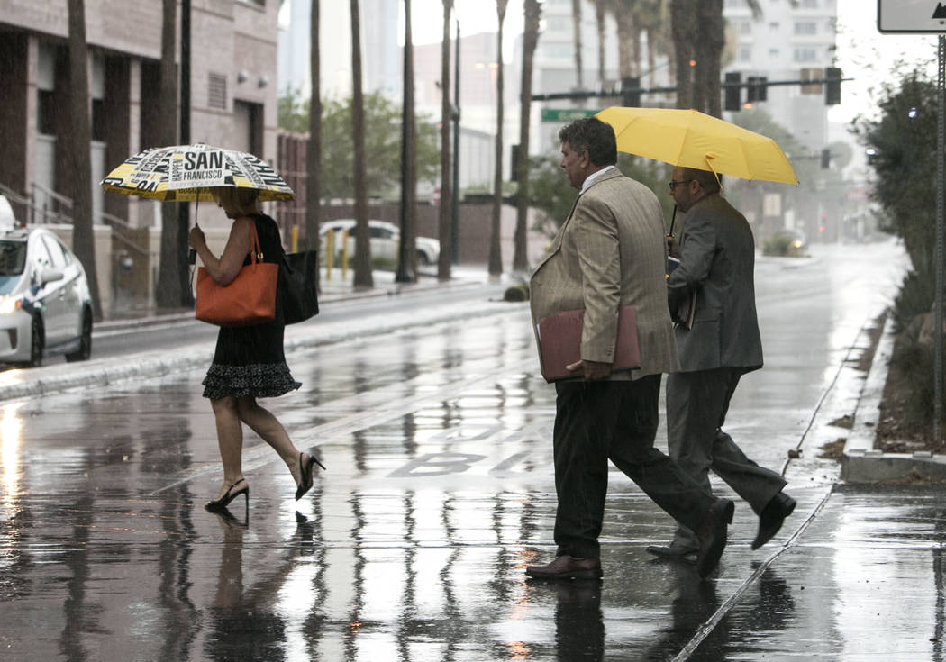 Pedestrian cross Lewis Avenue as light rain falls on Monday, Aug. 21, 2017, in Las Vegas. (Bizuayehu Tesfaye/Las Vegas Review-Journal) @bizutesfaye
