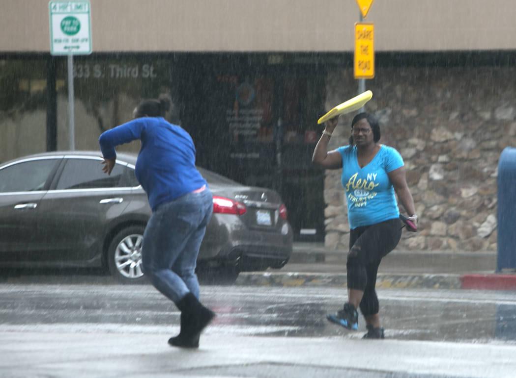 Pedestrian run for shelter as light rain falls on Monday, Aug. 21, 2017, in Las Vegas. (Bizuayehu Tesfaye/Las Vegas Review-Journal) @bizutesfaye