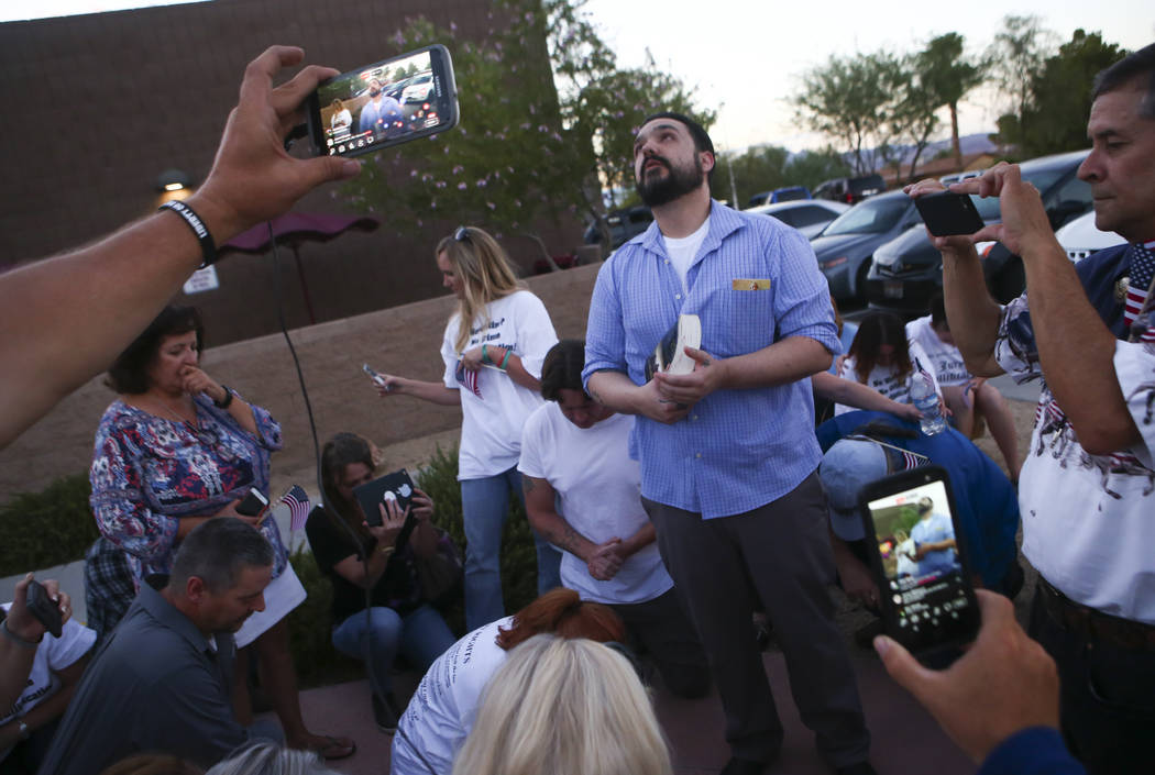 Eric Parker, center, says a pray after he and three other defendants in the Bunkerville standoff case were released at the Henderson Detention Center on Tuesday, Aug. 22, 2017. Chase Stevens Las V ...