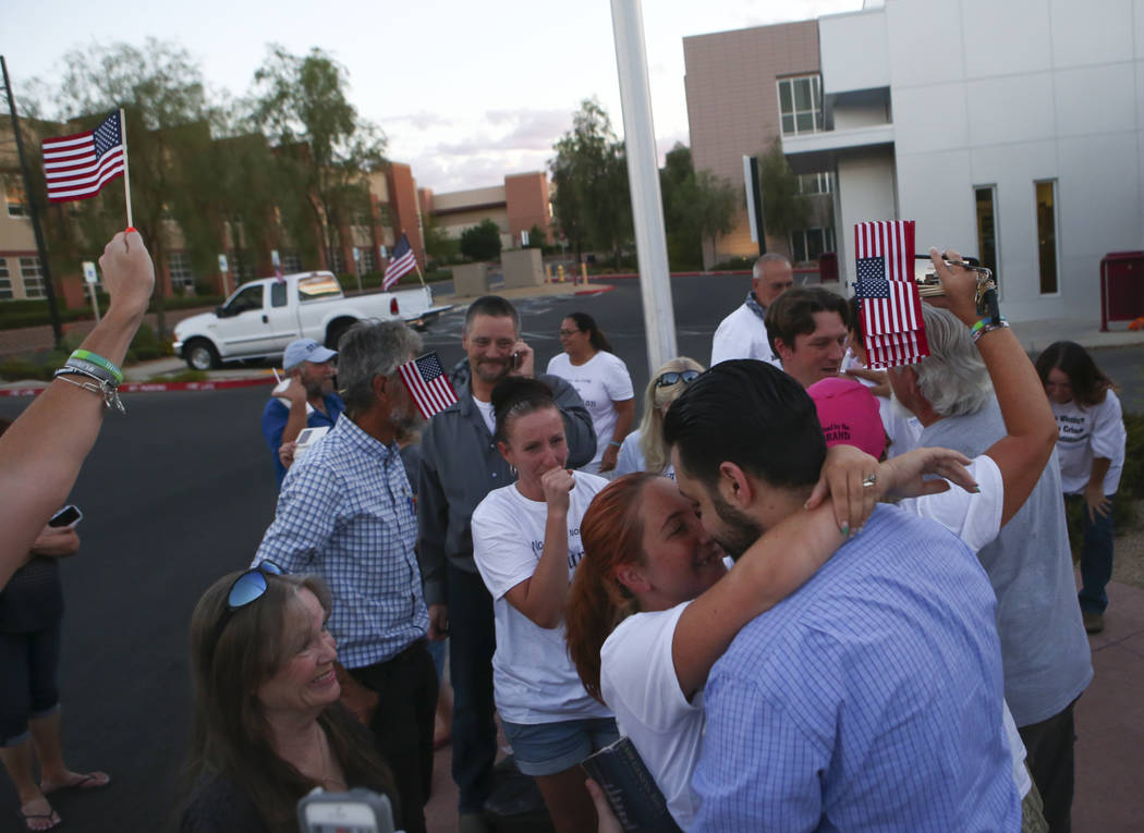 Andrea Parker embraces her husband Eric Parker after he and three other defendants in the Bunkerville standoff case were released at the Henderson Detention Center on Tuesday, Aug. 22, 2017. Chase ...