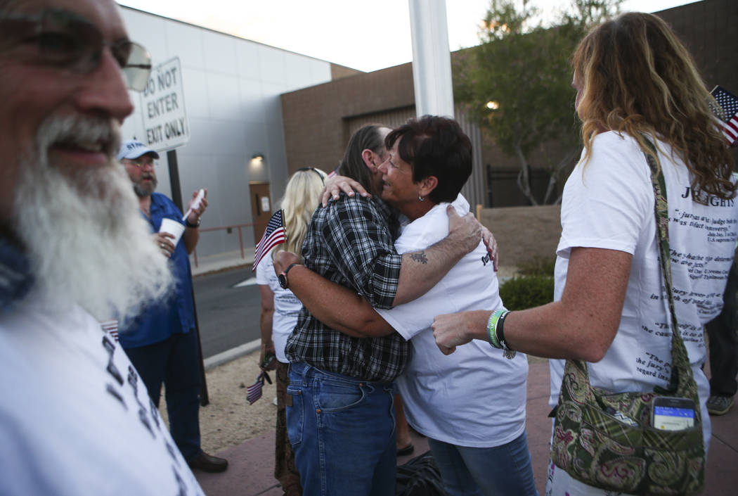 Scott Drexler, center left, is embraced by Margaret Houston, sister of Cliven Bundy, after he and three other defendants in the Bunkerville standoff case were released at the Henderson Detention C ...