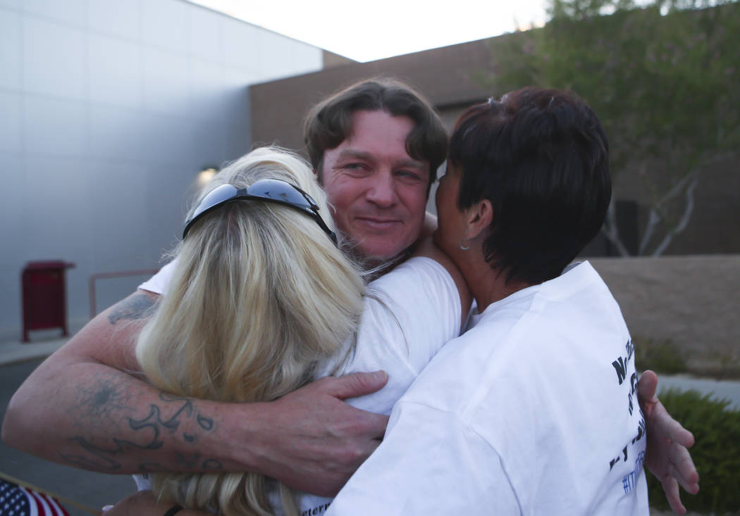 Steven Stewart is embraced after he and three other defendants in the Bunkerville standoff case were released at the Henderson Detention Center on Tuesday, Aug. 22, 2017. Chase Stevens Las Vegas R ...