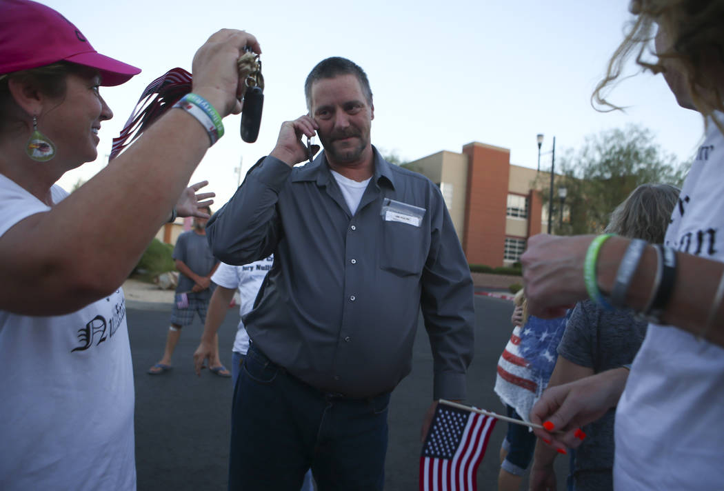 Ricky Lovelien makes a phone call after he and three other defendants in the Bunkerville standoff case were released at the Henderson Detention Center on Tuesday, Aug. 22, 2017. Chase Stevens Las  ...