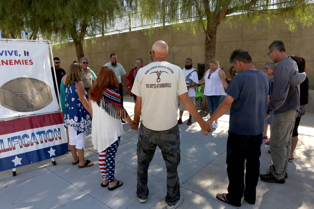 Protesters gather in a prayer circle outside the federal courthouse during the Bunkerville standoff retrial in Las Vegas on Tuesday, Aug. 15, 2017. Michael Quine Las Vegas Review-Journal.com @Vegas88s