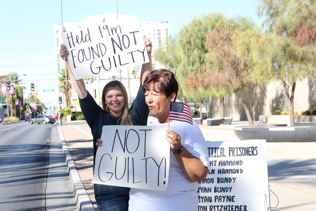 Cliven Bundy's daughter, Bailey Bundy Logue, left, and Margaret Houston of Logandale wave signs outside the Lloyd George U.S. Courthouse to passers-by on Las Vegas Boulevard after the not guilty ...