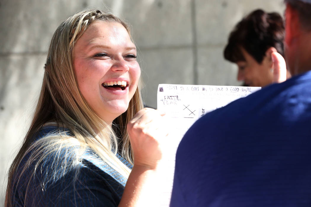 Cliven Bundy's daughter, Bailey Bundy Logue, holds up a score sheet outside the Lloyd George U.S. Courthouse with a record of the verdicts of each defendant's charges during the Bunkerville st ...