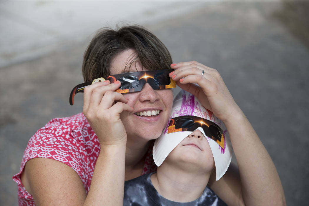 Emma Pease-Byron, left, and her daughter Lilah, 3, watch the solar eclipse at the Keeping Youth Educated daycare in Las Vegas, on Monday, Aug. 21, 2017. Erik Verduzco Las Vegas Review-Journal @Eri ...