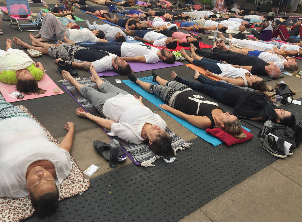 "About 200 yogis gather at Downtown Summerlin on Monday, Aug. 21, 2017, to ""clear bad karma"" and absorb the energy of the solar eclipse. Briana Erickson Las Vegas Review-Journal"