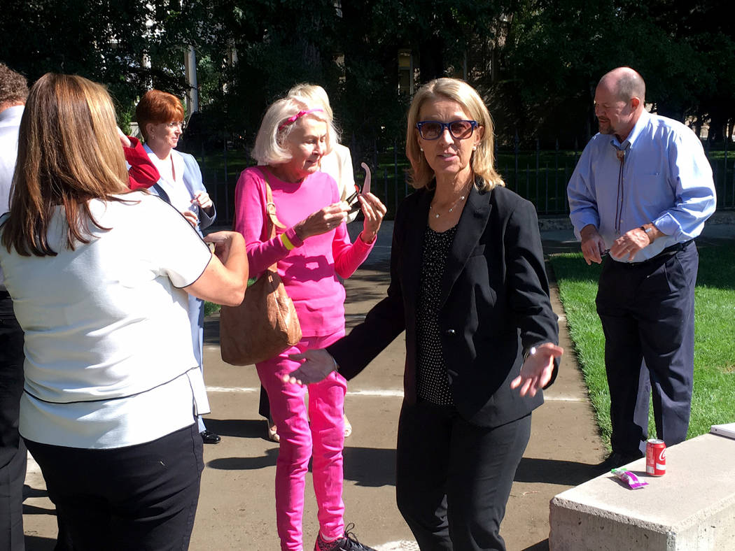 Secretary of State Barbara Cegavske and her staff came out for a look at the rare eclipse near the Capitol on Monday, Aug. 21, 2017. Sean Whaley Las Vegas Review-Journal