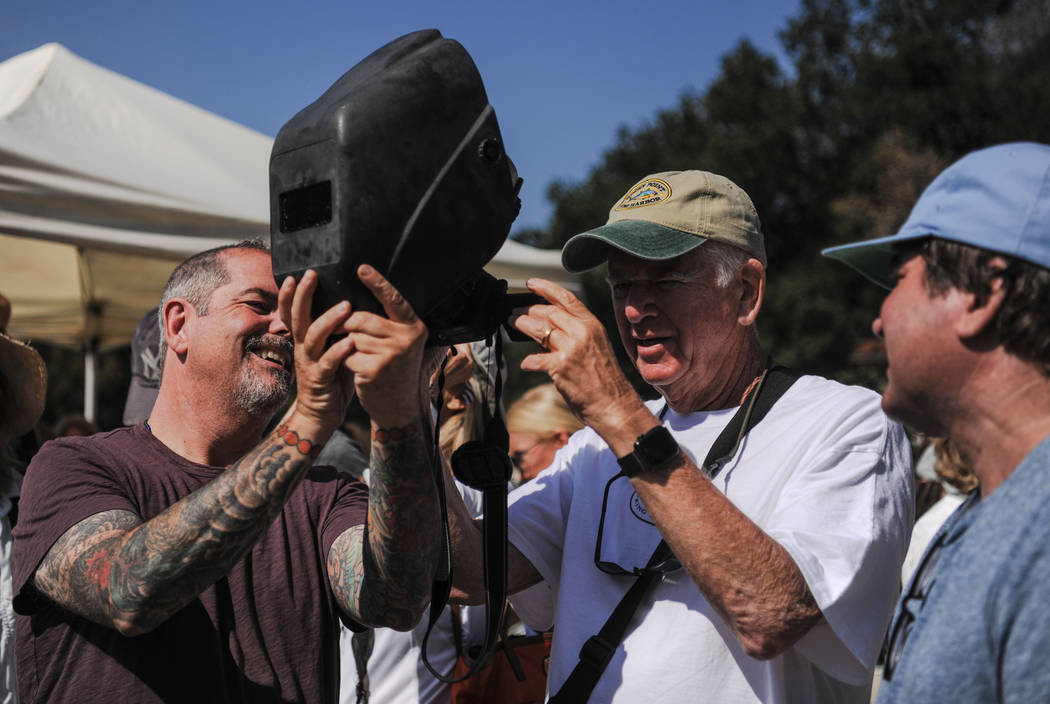 Mitch Rosenthal, left, and Steve Davis, right, use the welding mask as a filter for a camera phone at King Gillette Ranch in Calabasas, California, on Monday, Aug. 21, 2017. Morgan Lieberman Las V ...