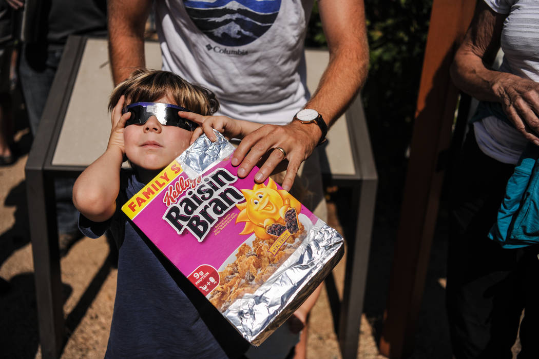 Malibu resident Miles Carlsen, 5, plays with eclipse glasses before his first day of kindergarten at King Gillette Ranch in Calabasas, California, on Monday, Aug. 21, 2017. Morgan Lieberman Las Ve ...