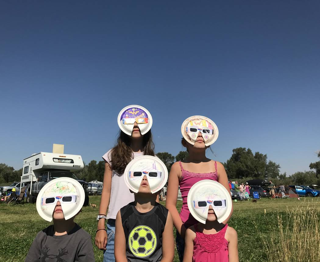 Young eclipse watchers in Rigby, Idaho, show off their custom solar shades Monday. Henry Brean/Las Vegas Review-Journal