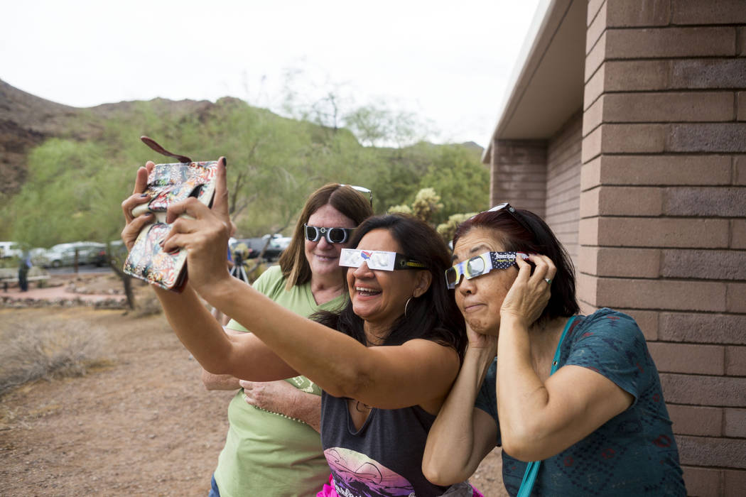 Charlene Wiesenborn, left, Linda Larkin, and Mieko Braun take a selfie during the eclipse viewing party at the Lake Mead Visitor Center in Boulder City, Monday, Aug. 21, 2017. Elizabeth Brumley La ...