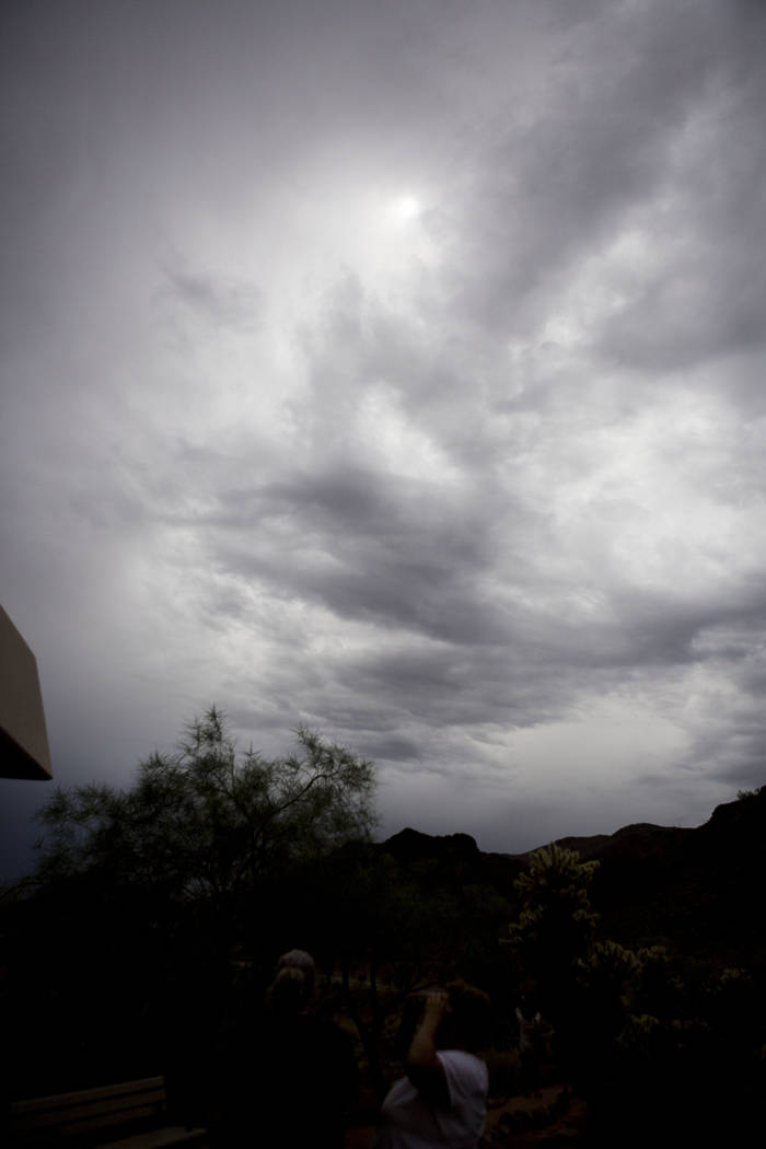 A small circle of light peeks through the dense clouds  during the eclipse viewing party at the Lake Mead Visitor Center in Boulder City, Monday, Aug. 21, 2017. Elizabeth Brumley Las Vegas Review- ...