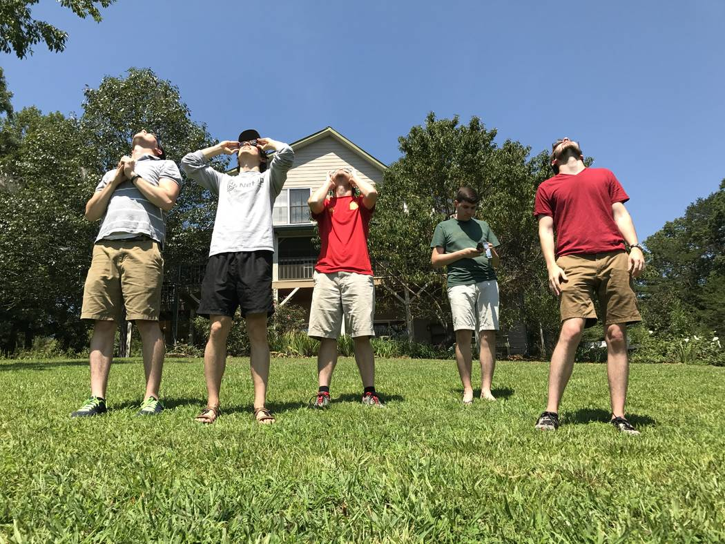 Tyson Badders, Marcus Keely, Matt Steen, Ryan Niland, Chris Cotter watch the solar eclipse in Brasstown, North Carolina. Harrison Keely/Las Vegas Review-Journal