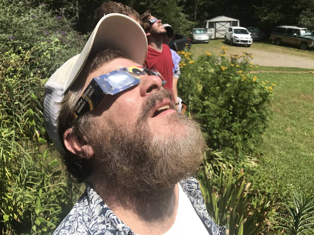 David Layfield watches the solar eclipse in Brasstown, North Carolina. Harrison Keely/Las Vegas Review-Journal