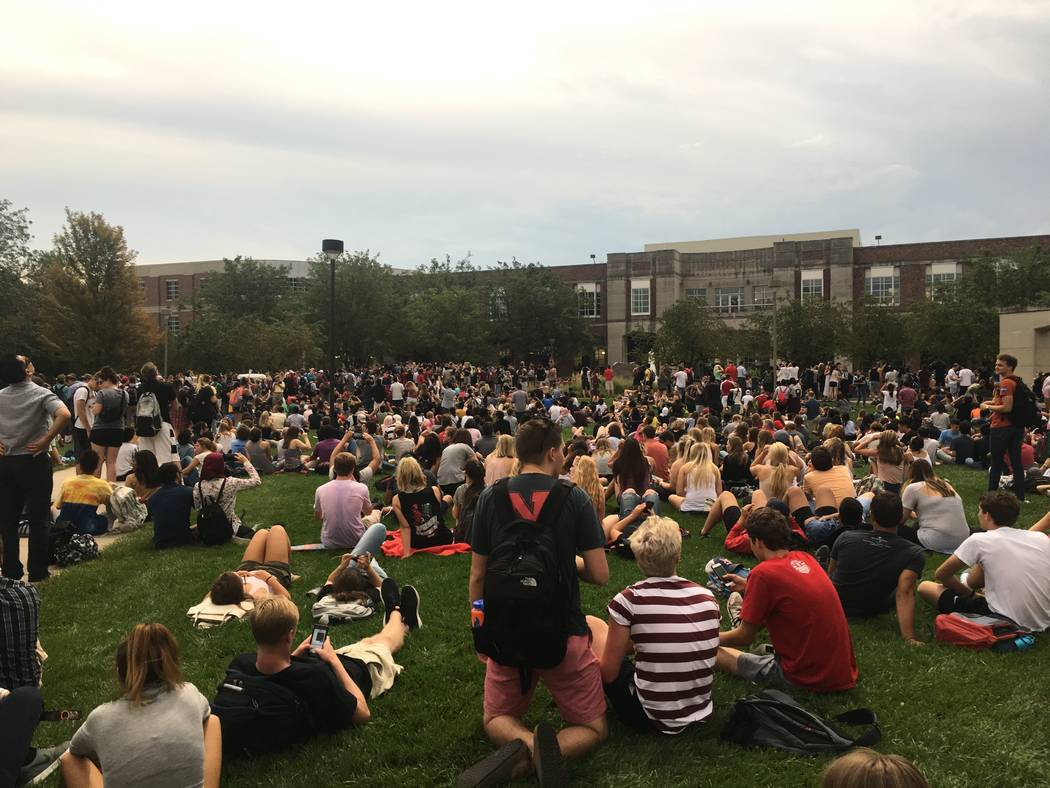Students wait for the moment of totality at the University Nebraska-Lincoln's City Campus Green Space on Monday, Aug. 21. (Bailey Schulz/Las Vegas Review-Journal)