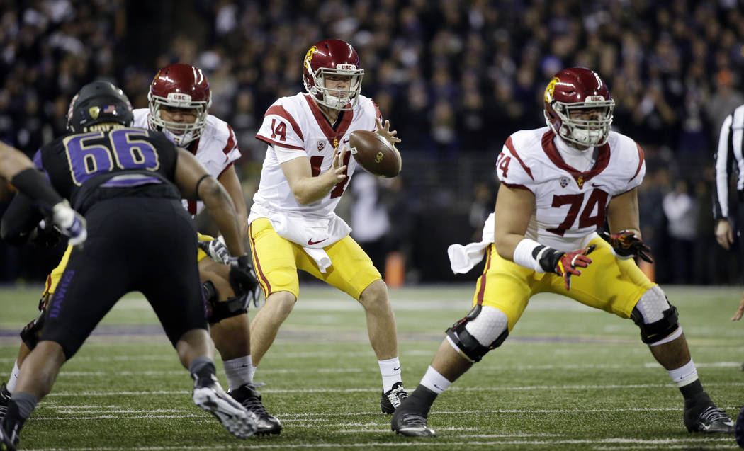 FILE - In this Nov. 12, 2016, file photo, Southern California quarterback Sam Darnold takes a snap during the team's NCAA college football game against Washington in Seattle. USC is in the No. 4 s ...