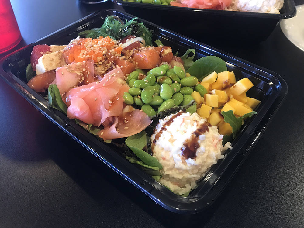 A large bowl at Poke Heaven included edamame, mango, pickled ginger, salmon, ahi, tofu, seaweed salad and imitation crab salad on a bed of salad greens. (Madelyn Reese/View) @MadelynGReese