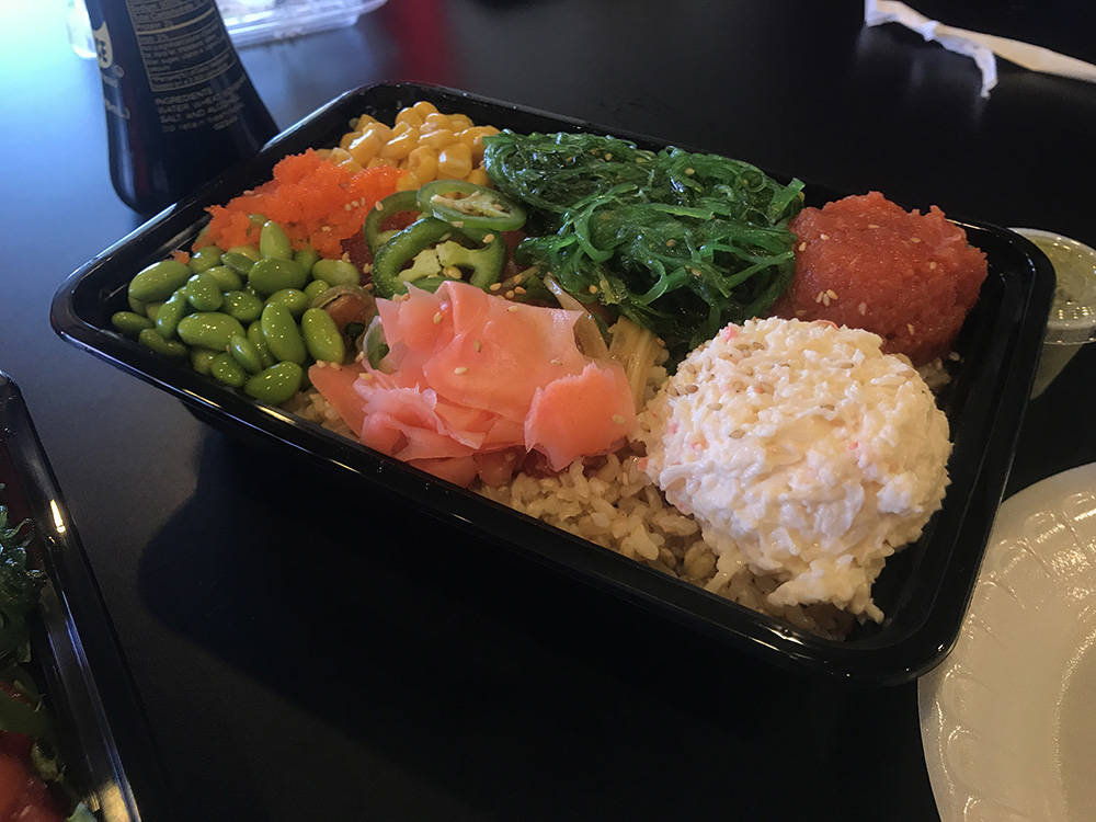 A large bowl at Poke Heaven included rice, spicy tuna, ahi, salmon, edamame, crab salad, seaweed salad, jalapenos, corn and pickled ginger. (Madelyn Reese/View) @MadelynGReese