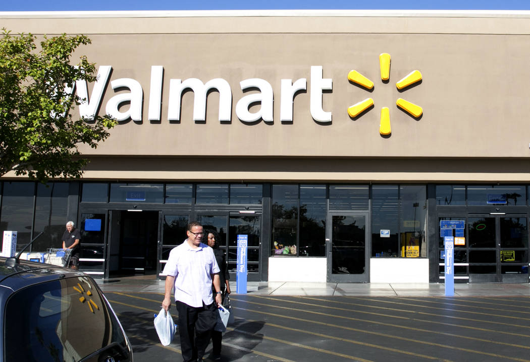 Customers leave a Wal-Mart store inside Cheyenne Commons' 35-acre property at the southwest corner of Rainbow Boulevard and Cheyenne Avenue on Tuesday, Aug. 22, 2017, in Las Vegas. (Bizuayehu Tesf ...