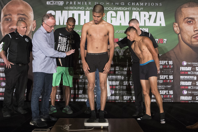 Alexis Santiago steps on the scale during weigh-ins at the Cosmopolitan hotel-casino on Thursday, Sept. 15, 2016 in Las Vegas. Loren Townsley/Las Vegas Review-Journal Follow @lorentownsley