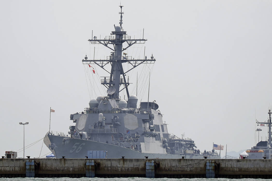 "The USS John S. McCain is seen docked at Changi naval base after its accident on Monday, Aug. 21, 2017 in Singapore. The USS John S. McCain was docked at Singapore's naval base with ""sign ..."