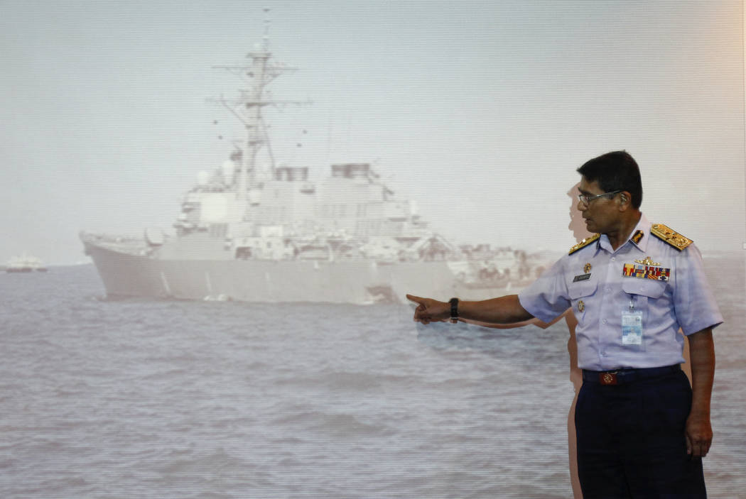 Malaysian Maritime Director Indera Abu Bakar points the damage of USS John S. McCain shown on a screen during a press conference in Putrajaya, Malaysia, Monday, Aug. 21, 2017. The U.S. Navy said t ...