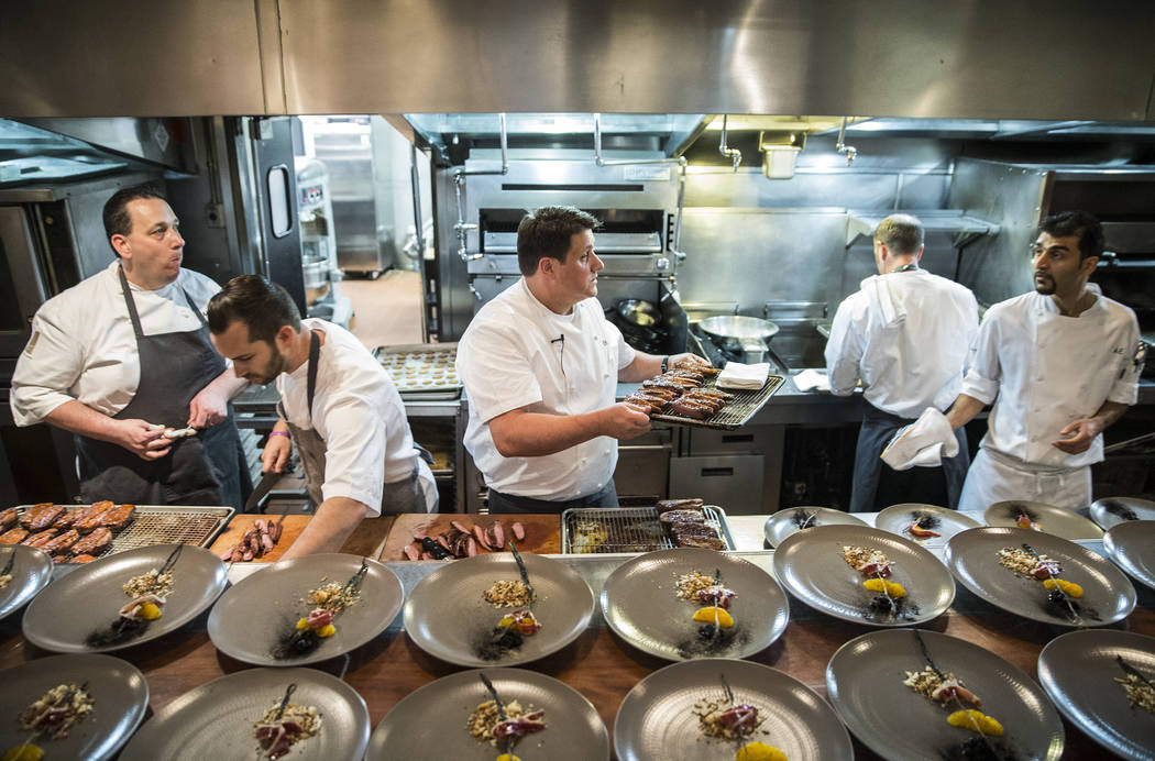Duck is plated during the 25th Anniversary Lunch with Wolfgang Puck at Vegas Uncork'd on Friday, April 28, 2017, at Spago, in Las Vegas. The event is sponsored by Bon Apptit and offers food and wi ...