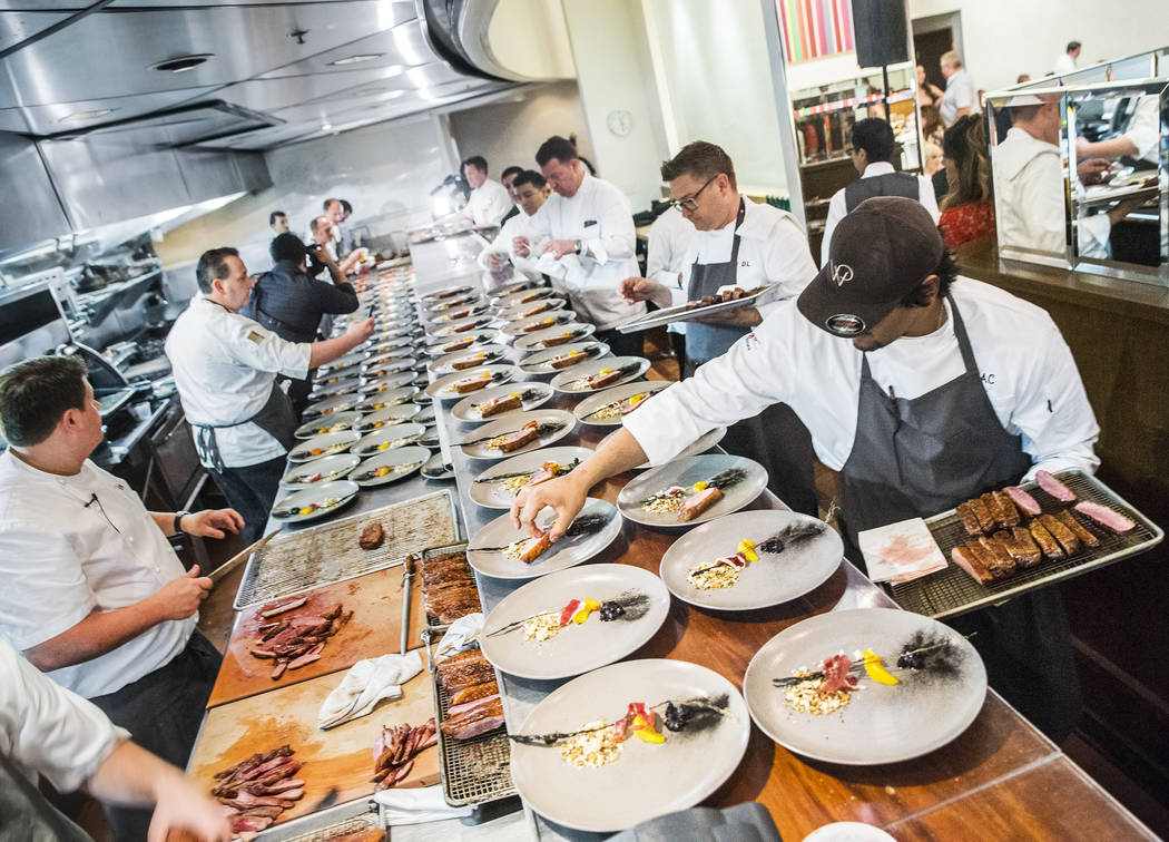Duck is plated during the 25th Anniversary Lunch with Wolfgang Puck at Vegas Uncork'd on Friday, April 28, 2017, at Spago, in Las Vegas. The event is sponsored by Bon Appétit and offers food  ...