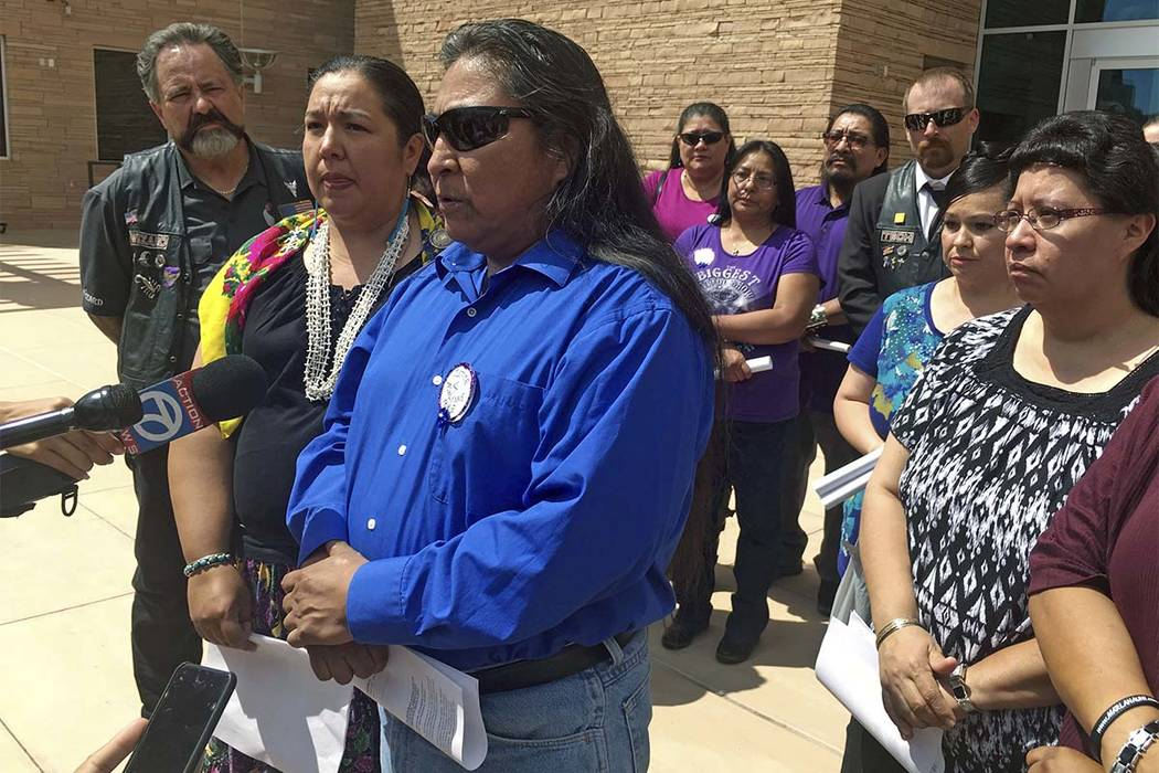 Gary Mike, front, father of 11-year-old Ashlynne Mike, speaks outside of federal court in Albuquerque, N.M., on Tuesday, Aug. 1, 2017. The man who admitted to killing the Navajo girl, Ashlynne Mik ...