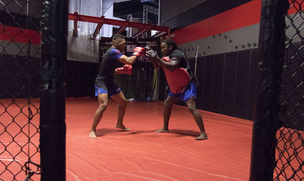 UFC lightweight Kevin Lee, left, trains for his five-round fight at UFC Fight Night 112 with the founder of Black Kobra Striking Systems, Dewey Cooper, at One Kick's Gym in Las Vegas, Tuesday, Jun ...