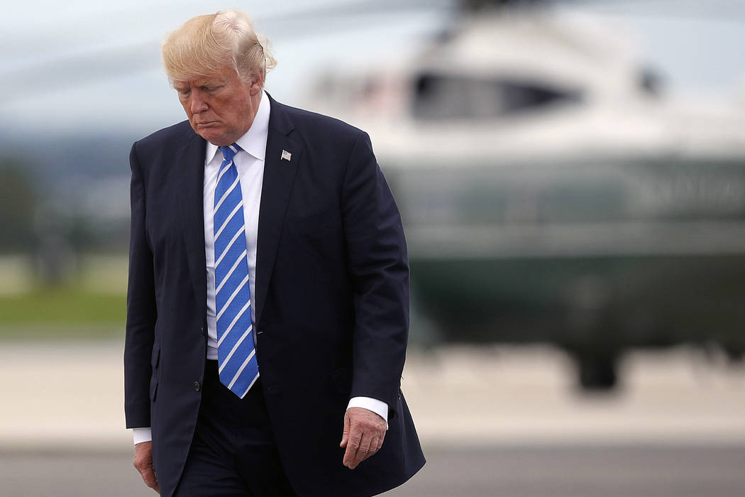 President Donald Trump walks across the tarmac before boarding Air Force One at Hagerstown Regional Airport, Aug. 18, 2017, in Hagerstown, Maryland. Trump is scheduled to visit Reno on Wednesday,  ...