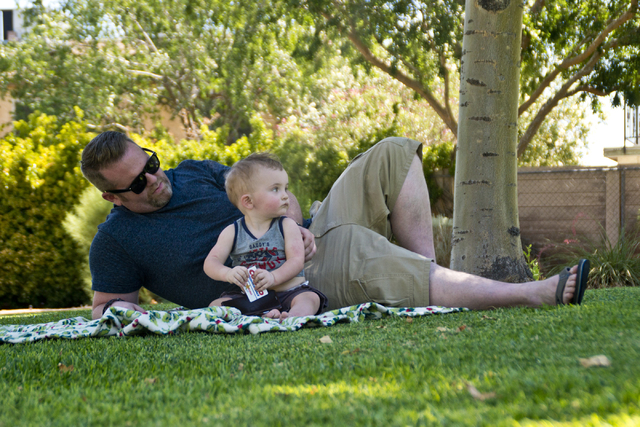 Brian and his son Logan Raffail relax in the shade at O'Callaghan Park in Henderson on Tuesday, June 14, 2016. Daniel Clark/Las Vegas Review-Journal Follow @DanJClarkPhoto