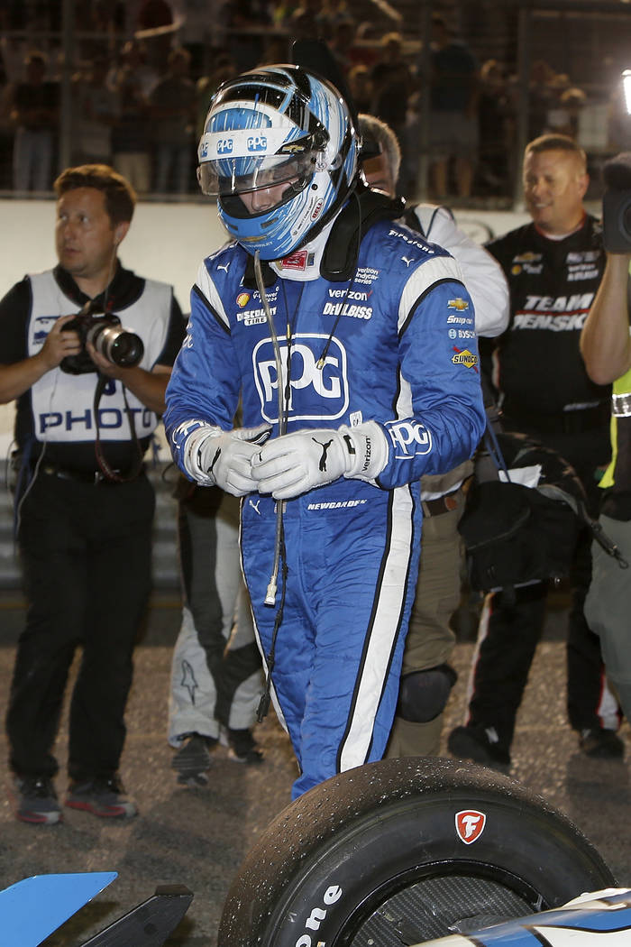 Josef Newgarden looks at his car after winning the IndyCar auto race Saturday, Aug. 26, 2017, at Gateway Motorsports Park in Madison, Ill. (AP Photo/Scott Kane)
