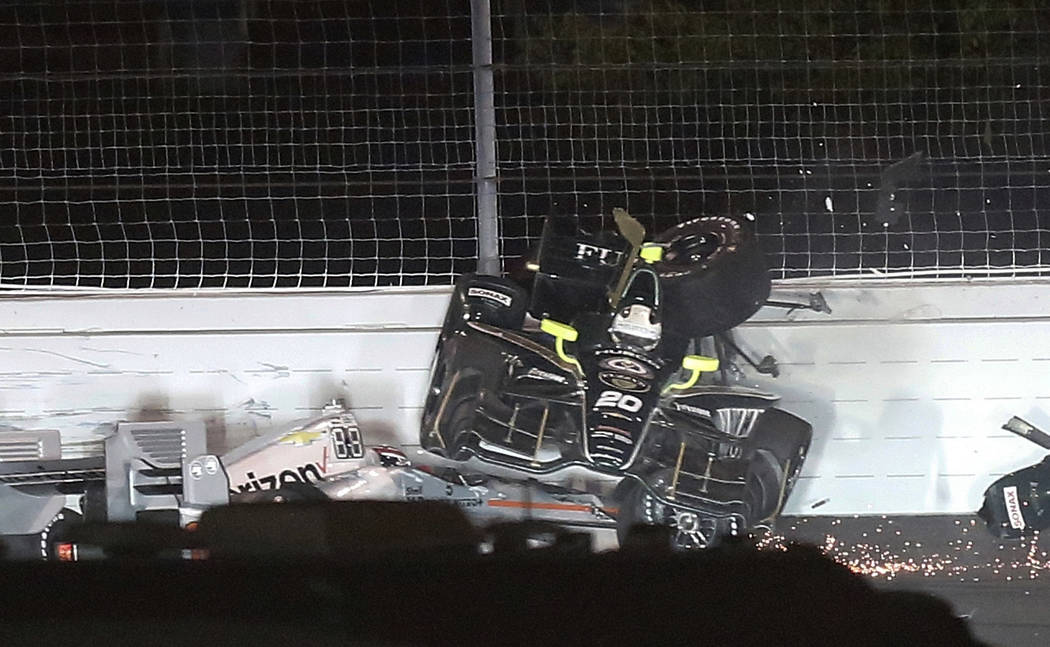 Ed Carpenter's car lands on top of the car driven by Will Power, of Australia, during a wreck in Turn 2 during the IndyCar auto race Saturday, Aug. 26, 2017, at Gateway Motorsports Park in Madison ...
