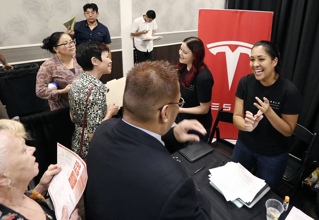 Job seekers meet with Ashley Summer, right, customer service recruiter for Tesla, during a job fair hosted by the Las Vegas Review-Journal at Palace Station on Thursday, Aug. 17, 2017, in Las Vega ...