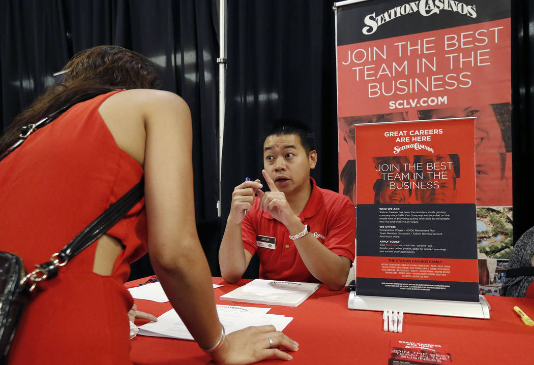 Jason Luong, right, employment recruiter for Texas Station & Fiesta Rancho, talks to a job seeker during a job fair hosted by the Las Vegas Review-Journal at Palace Station on Thursday, Aug. 1 ...
