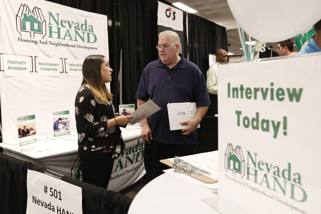 Steve Elman discusses his qualification with Chelsea Lee, learning and development manager at Nevada Hand, during a job fair hosted by the Las Vegas Review-Journal at Palace Station on Thursday, A ...