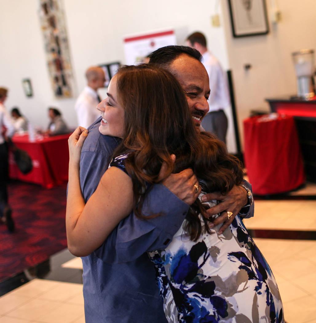 Albert Arebalos hugs his daughter Monica Rose Arebalos before the start of UNLV School of Medicine's white coat ceremony in Las Vegas on Aug. 25, 2017. Joel Angel Juarez Las Vegas Review-Journal @ ...
