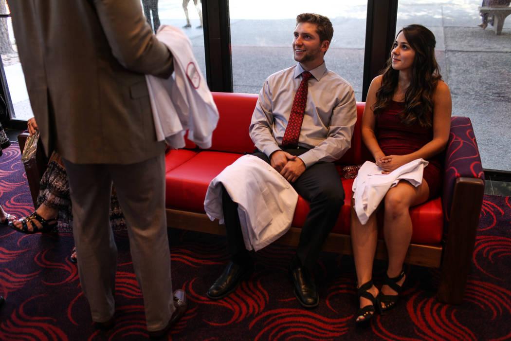 Cory Colombini and Sabrina Novenschi sit before the start of UNLV School of Medicine's white coat ceremony in Las Vegas on Aug. 25, 2017. Joel Angel Juarez Las Vegas Review-Journal @jajuarezphoto