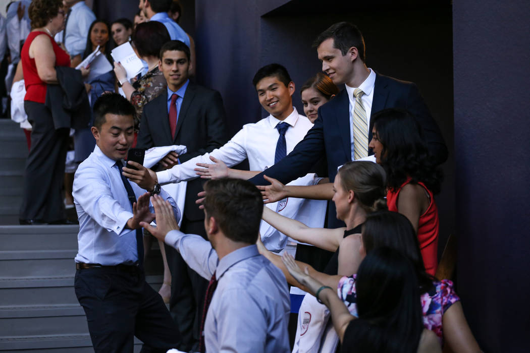 William Fang takes gets high fives from friends before the start of UNLV School of Medicine's white coat ceremony in Las Vegas on Aug. 25, 2017. Joel Angel Juarez Las Vegas Review-Journal @jajuare ...