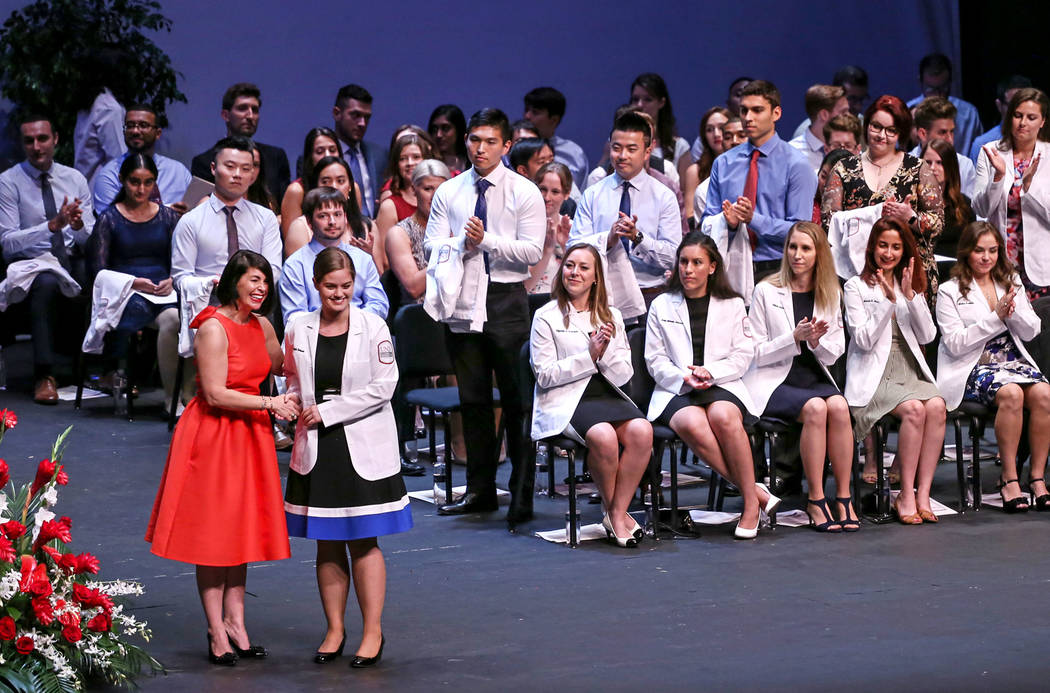 Anne Weisman, Ph.D., left, congratulates Crystal Dickson, right, after receiving her white coat during UNLV School of Medicine's inaugural class of 2021 ceremony in Las Vegas on Aug. 25, 2017. Joe ...