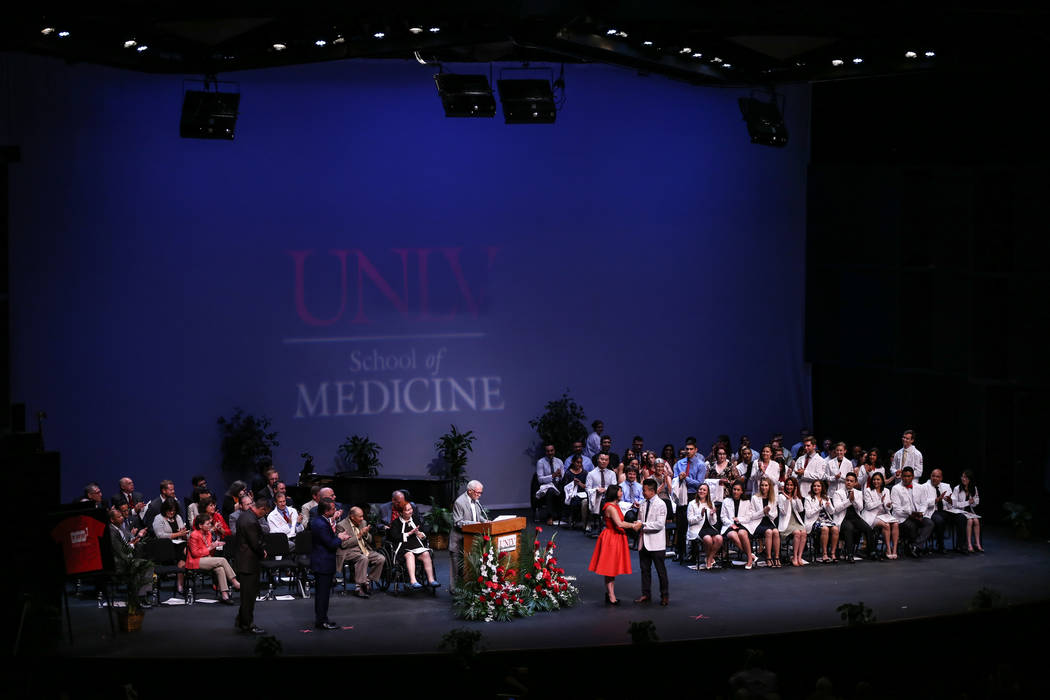 Students receive their white coat during UNLV School of Medicine's inaugural class of 2021 ceremony in Las Vegas on Aug. 25, 2017. Joel Angel Juarez Las Vegas Review-Journal @jajuarezphoto