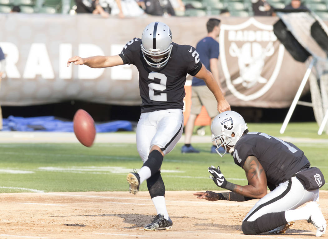 Oakland Raiders kicker Giorgio Tavecchio (2) practices field goals with punter Marquette King (7) ahead of the NFL preseason football game against the Los Angeles Rams, Saturday, Aug. 19, 2017. He ...