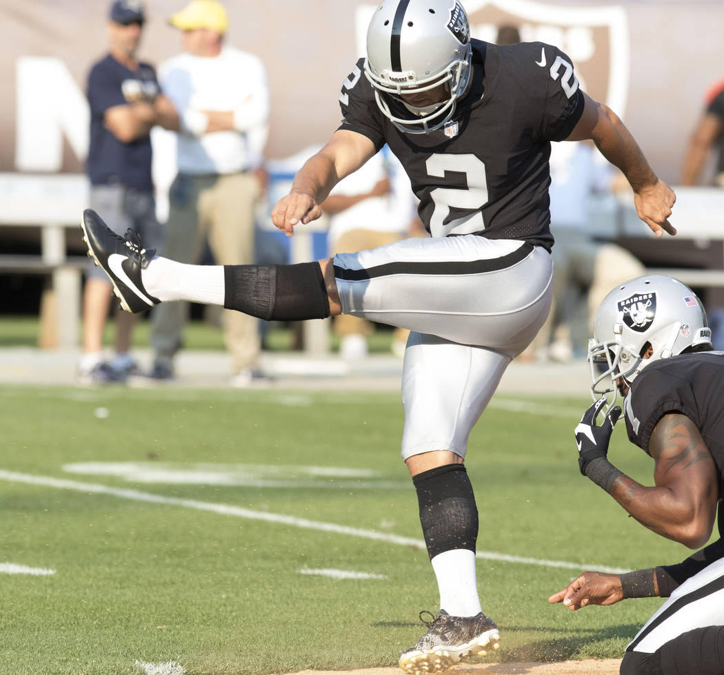 Oakland Raiders kicker Giorgio Tavecchio (2) goes through drills with punter Marquette King (7) ahead of the NFL preseason football game against the Los Angeles Rams, Saturday, Aug. 19, 2017. Heid ...