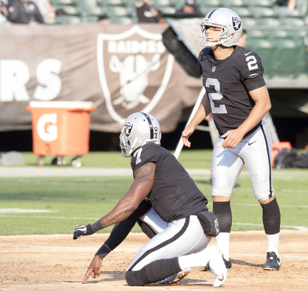 Oakland Raiders kicker Giorgio Tavecchio (2) goes through warm up drills with punter Marquette King (7) ahead of the NFL preseason football game against the Los Angeles Rams, Saturday, Aug. 19, 20 ...