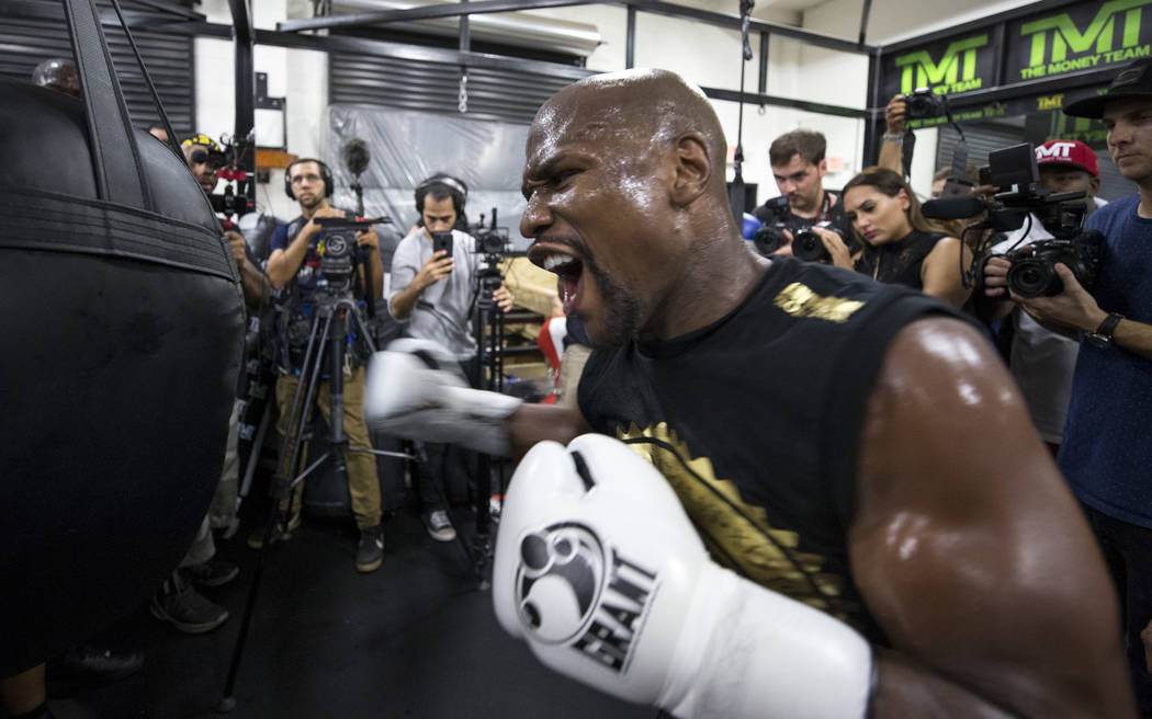 "Undefeated American boxer Floyd ""Money"" Mayweather Jr. works out for the media at his gym on Aug. 10 in Las Vegas. Mayweather is scheduled to fight Conor McGregor on Aug. 26 at the T-Mobile Arena. ..."